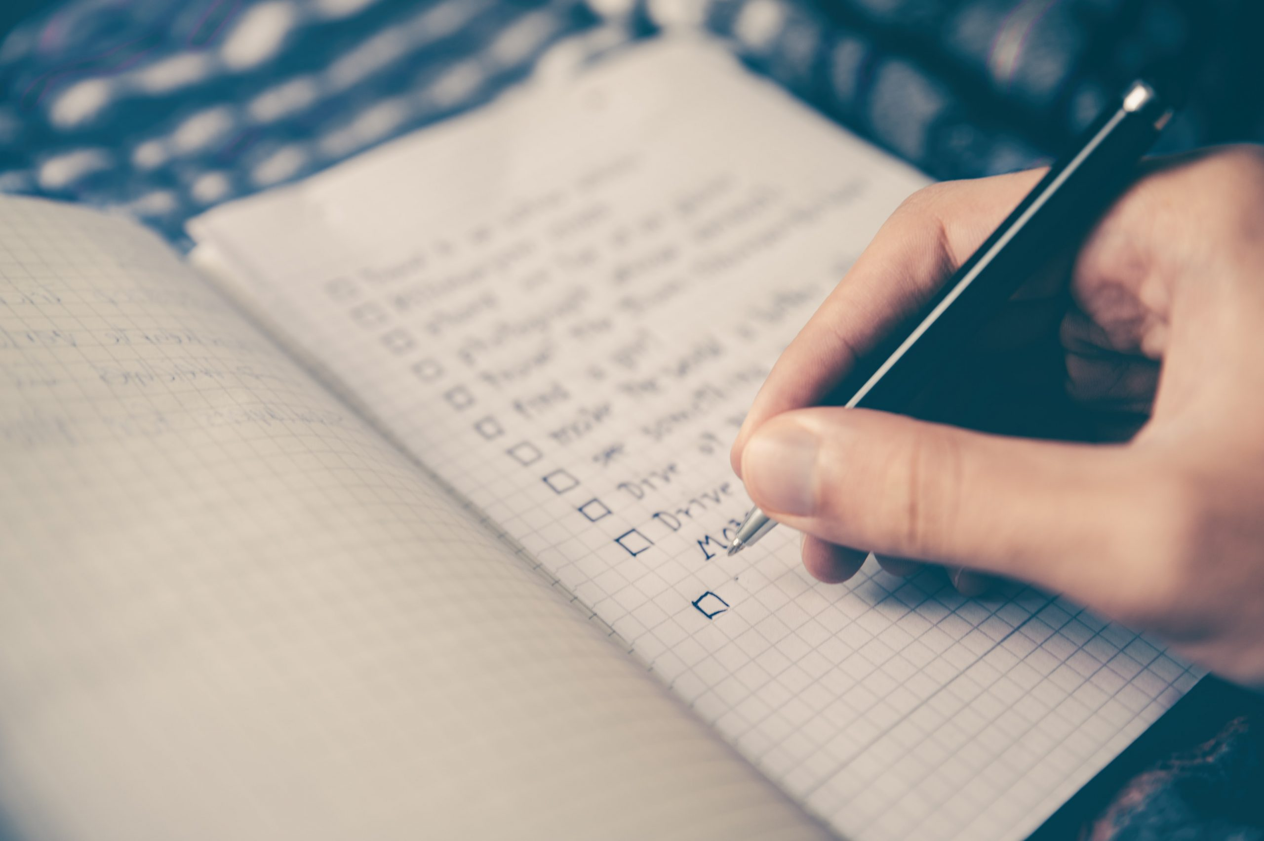 Person writing a to do list Photo by Glenn Carstens-Peters on Unsplash